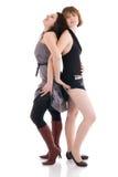 Dos muchachas atractivas jovenes aisladas en un blanco Imagenes de archivo