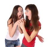 Dos muchachas con el chocolate Foto de archivo libre de regalías