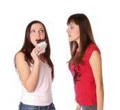 Dos muchachas con el chocolate Imagenes de archivo
