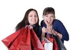 Dos muchachas con los bolsos Imagen de archivo