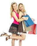 Dos muchachas con los bolsos Fotografía de archivo libre de regalías