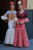 Dos muchachas con los vestidos del flamenco Foto de archivo libre de regalías