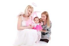 Dos muchachas con un bebé Imagen de archivo libre de regalías