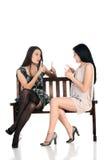 Dos muchachas en el banco Imagen de archivo libre de regalías