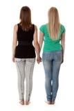 Dos muchachas en pantalones vaqueros Foto de archivo libre de regalías