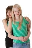 Dos muchachas en pantalones vaqueros Imagen de archivo