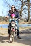 Dos muchachas en una moto Foto de archivo libre de regalías
