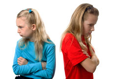 Dos muchachas están enojadas en uno a Foto de archivo