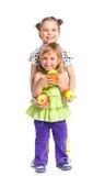 Dos muchachas felices con la manzana Fotografía de archivo libre de regalías