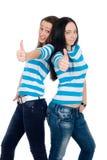 Dos muchachas felices que exponen los pulgares Foto de archivo libre de regalías