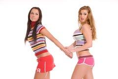 Dos muchachas juguetonas hermosas Imagen de archivo libre de regalías