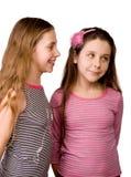 Dos muchachas que comparten ideas Foto de archivo libre de regalías