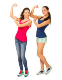 Dos muchachas sonrientes deportivas jovenes Imágenes de archivo libres de regalías