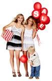 Dos muchachas y un niño pequeño con la muestra de la venta imagen de archivo