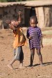 Dos muchachos del Masai en jugar occidental de la ropa Imagen de archivo libre de regalías