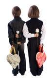 Dos muchachos que sostienen las flores imagenes de archivo