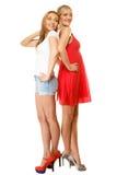 Dos mujeres atractivas de la moda en ropa del verano Imágenes de archivo libres de regalías