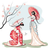 Dos mujeres chinas con los parasoles fotografía de archivo