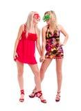 Dos mujeres en vidrios locos del payaso Foto de archivo