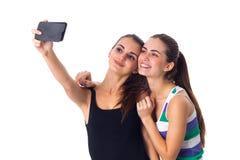 Dos mujeres jovenes que hacen el selfie Foto de archivo libre de regalías
