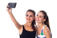 Dos mujeres jovenes que hacen el selfie Imágenes de archivo libres de regalías