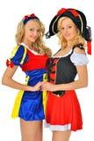 Dos mujeres rubias hermosas en trajes del carnaval Fotografía de archivo libre de regalías