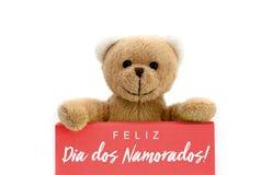 DOS Namorados de Feliz Dia dans la langue portugaise : Texte heureux de jour de Valentine's et ours de nounours brun Photographie stock