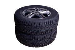 Dos neumáticos del invierno con los puntos Imagen de archivo