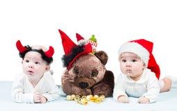 Dos niñas de santa en la Navidad Fotos de archivo