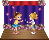 Dos niños en el centro de la etapa ilustración del vector
