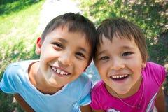 Dos niños felices Imágenes de archivo libres de regalías
