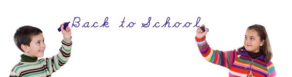 Dos niños que escriben de nuevo a escuela Foto de archivo libre de regalías