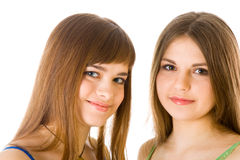 Dos novias jovenes felices que dicen secreto Imagenes de archivo