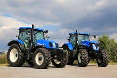 Dos nueva Holland Agricultural Tractors Imagen de archivo libre de regalías