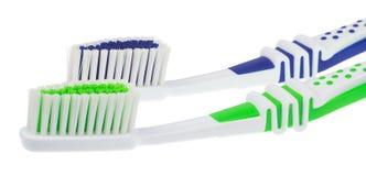 Dos nuevos cepillos de dientes Fotos de archivo