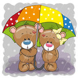 Dos osos lindos de la historieta con el paraguas ilustración del vector