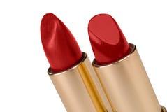 Dos palillos de lápiz labial rojo Fotos de archivo libres de regalías
