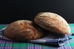 Dos panes de pan marrón del centeno Foto de archivo