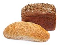 Dos panes de pan rubicundos con los gérmenes de girasol Foto de archivo