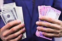 Dos paquetes de dinero en las manos imágenes de archivo libres de regalías