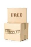 Dos paquetes del cartón con la impresión del envío gratis Imagen de archivo libre de regalías