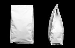 Dos paquetes plásticos Imagen de archivo libre de regalías