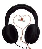 Dos pares de auriculares Auriculares negros y rojos fotografía de archivo libre de regalías