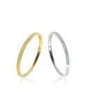 Dos pares de las pulseras de oro y de plata con los diamantes Foto de archivo libre de regalías
