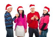 Dos pares tuestan para la Navidad Foto de archivo libre de regalías