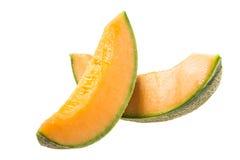 Dos partes de corte del melón Fotos de archivo