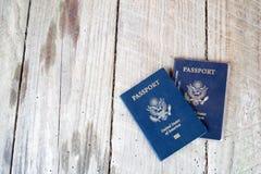 Dos pasaportes en el fondo de madera Imágenes de archivo libres de regalías
