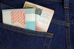 Dos pasaportes en un bolsillo del pantalón Imágenes de archivo libres de regalías