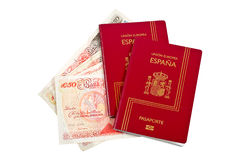 Dos pasaportes y dineros de España Imagen de archivo libre de regalías