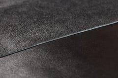 Dos pedazos de cuero negro Fotos de archivo libres de regalías